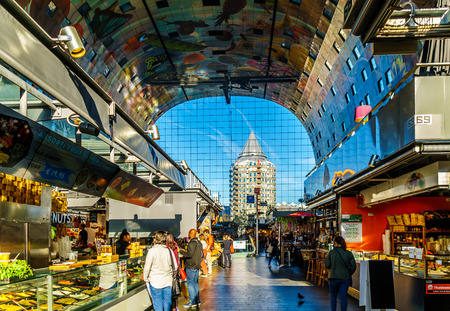 Rotterdam / The Netherlands - Sept. 26, 2018: The modern architecture of Market Hall, a multi purpose building  with its many eateries, shops in the center and apartments in the outside horseshoe