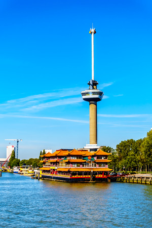 Rotterdam  The Netherlands - Sept. 26, 2018: The Euromast Tower with a Floating Chinese Restaurant viewed from the tourist boat on the Nieuwe Maas River in the port of Rotterdam