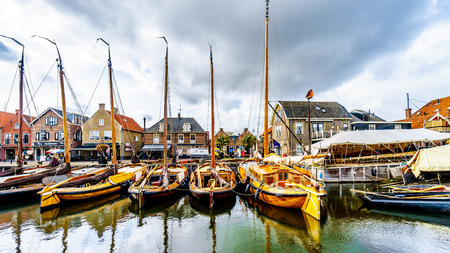 Bunschoten-Spakenburg/the Netherlands - Oct. 2, 2018: Traditional Wooden Fishing Boats, called Botters, moored in the harbor of the historic fishing village of Bunschoten-Spakenburg in the Netherlands