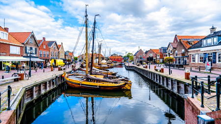 Bunschoten-Spakenburgthe Netherlands - Oct. 2, 2018: Traditional Wooden Fishing Boats, called Botters, moored in the harbor of the historic fishing village of Bunschoten-Spakenburg in the Netherlands