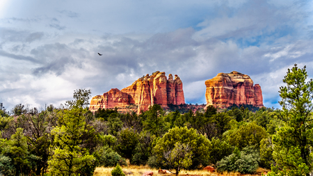 The colorful layers in Cathedral Rock under dark clouds, one of the many well known red rocks in Coconino National Forest near the town of Sedona in northern Arizona, USA