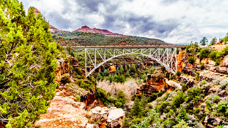 The steel structure of Midgely Bridge on Arizona SR89A between Sedona and Flagstaff. The bridge span crosses Wilson Canyon where it joins the Oak Creek Canyon just north of Sedona in northern Arizona