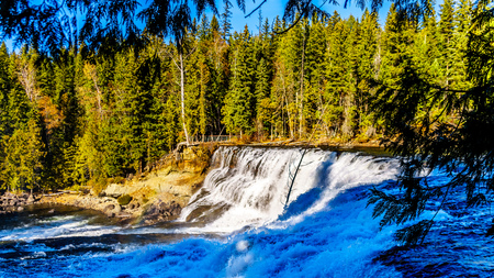 Water of the Murtle River as it tumbles over the cusp of Dawson Falls in Wells Gray Provincial Park in British Columbia, Canada, viewed from the south side of the river
