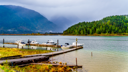 Fishing and Pleaseure Boats moored at the dock at Pitt Lake in the Coast Mountain Range in the Fraser Valley of British Columbia, Canada