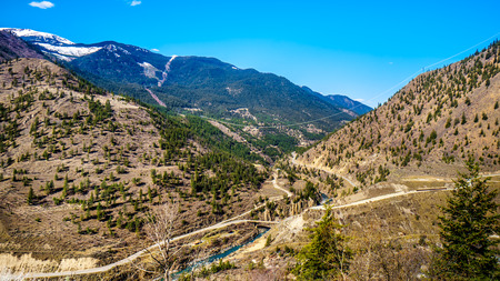 View of the Bridge River Valley from Highway 99, just north of the town of Lillooet. Here the Bridge River flows into the Fraser River as it flows south toward Vancouver, British Columbia