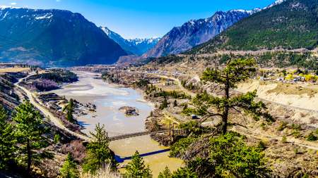 View of The Old Bridge, a single lane bridge over the Fraser River at the town just north of the town of Lillooet, British Columbia, Canada Stock Photo