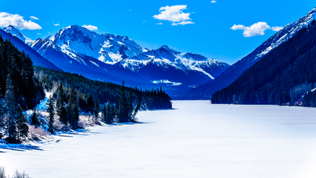 Frozen Duffey Lake and the snow capped peaks around  lake. Mount Rohr at the south end of the lake along Highway 99 between Pemberton and Lillooet, British Columbia