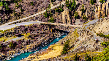 View of the bridge over the turquoise water of the Bridge River, just north of the town of Lillooet, British Columbia, Canada