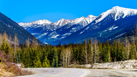 View of the snow capped Coast Mountains along Highway 99, also called The Duffey Lake Road, as it winds through the Coast Mountain Range between Pemberton and Lillooet in southern British Columbia