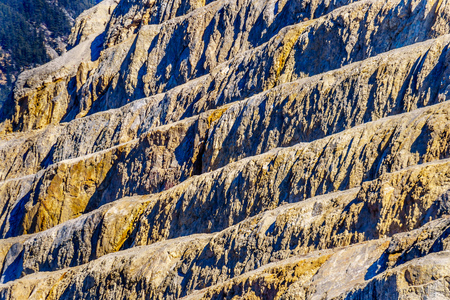 The terraced mountain side of a limestone Quarry in Marble Canyon Provincial Park along Highway 99 between the towns of Cache Creek and Lillooet in Southern British Columbia, Canada