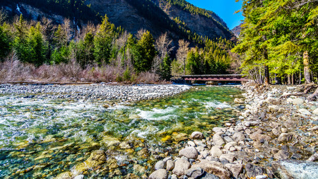 Partly frozen Cayoosh Creek which runs for the most part next to Highway 99, the Duffey Lake Road, between Pemberton and Lillooet in southern British Columbia, Canada