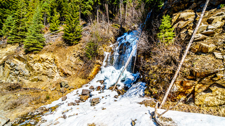 Frozen waterfall in the Coast Mountains along the Duffey Lake Road between the towns of Lillooet and Pemberton in British Columbia, Canada