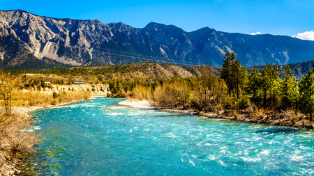 The clear turquoise waters of the Cayoosh Creek just before it runs into the Fraser River at the town of Lillooet in British Columbia, Canada