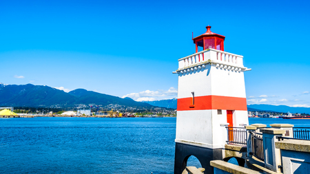 The Lighthouse at Brockton Point on the famous Seawall pathway in Vancouver's Stanley Park