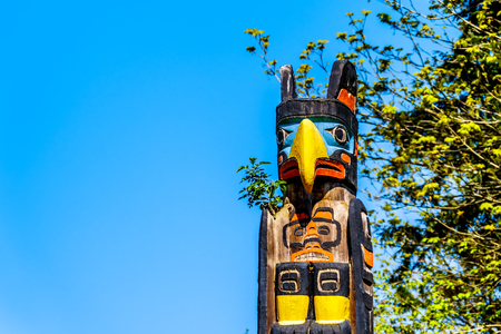 The top of the colorful 'Oscar Maltipi Totem Pole' depicting a Thunderbird. The totem pole is located in Stanley Park, Vancouver, Canada
