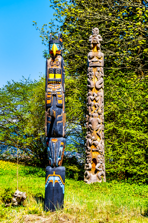 The 'Oscar Maltipi Totem Pole' and 'Beaver Crest Totem Pole' in Stanley Park. The second is different as it is unpainted and it's main body is circular