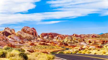 The White Dome Road winds through the colorful red, yellow and white sandstone rock formations in the Valley of Fire State Park in Nevada, USA