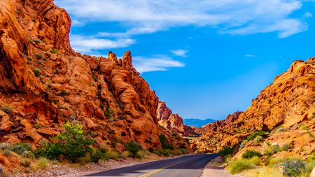 The Mouses Tank Road surrounded by Red Aztec Sandstone Mountains in the Valley of Fire State Park in Nevada, USA