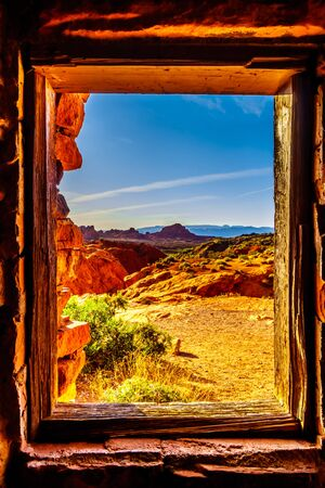 View of the red sandstone rock formations from one of the windows in the historic sandstone cabins build in 1934 by Civilian Conservation Corps in the Valley of Fire State Park, Nevada, USA Stockfoto