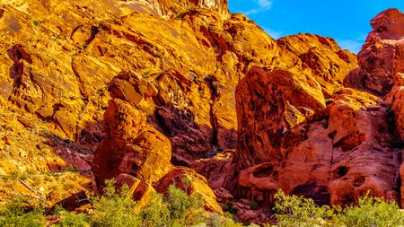 Red Aztec Sandstone Mountains at Sunrise at the Mouses Tank Road in the Valley of Fire State Park in Nevada, USA