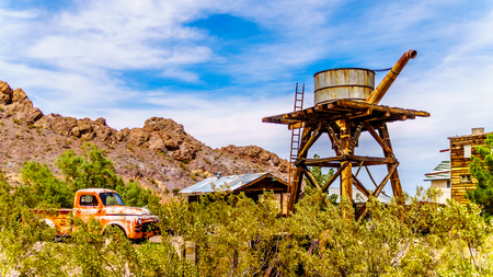 El Dorado Canyon, Nevada/USA - June 10 2019: Vintage water tower and buildings, used in several old movies, are still in the old mining town of El Dorado in the Eldorado Canyon in the Nevada Desert