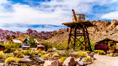 El Dorado Canyon, NevadaUSA - June 10 2019: Vintage water tower and buildings, used in several old movies, are still in the old mining town of El Dorado in the Eldorado Canyon in the Nevada Desert Editorial
