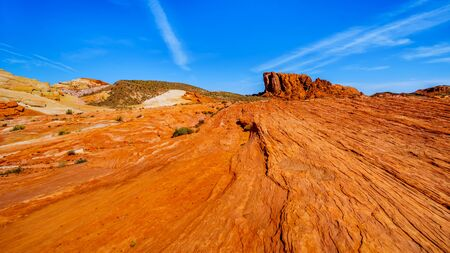 The colorful red, yellow and white banded rock formations along the Fire Wave Trail in the Valley of Fire State Park in Nevada, USA Imagens