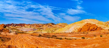 Panorama View of the colorful red, yellow and white banded rock formations along the Fire Wave Trail in the Valley of Fire State Park in Nevada, USA