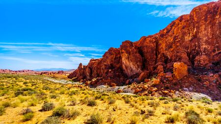 The colorful red rock formation along the Fire Wave Trail in the Valley of Fire State Park in Nevada, USA Imagens