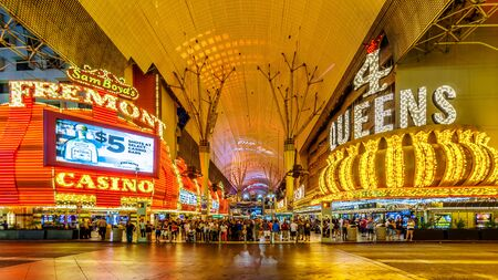Las Vegas, Nevada/USA - June 9, 2019: Hustle and bustle of crowds in the evening on the famous Fremont Street in the heart of downtown Las Vegas with its many Casinos, Neon Lights and Entertainment Editöryel