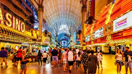 Las Vegas, Nevada/USA - June 9, 2019: Hustle and bustle of crowds in the evening on the famous Fremont Street in the heart of downtown Las Vegas with its many Casinos, Neon Lights and Entertainment