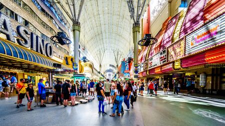 Las Vegas, Nevada/USA - June 9, 2019: Hustle and bustle of crowds during the day on the famous Fremont Street in the heart of downtown Las Vegas with its Casinos, Neon Lights and Street Entertainment Editöryel