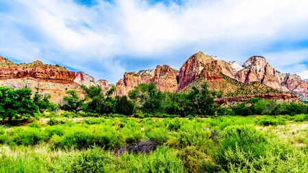 The West Temple, Sundial and Altar of Sacrifice Mountains viewed from the Parus Trail which follows along and over the meandering Virgin River in Zion National Park in Utah, USA