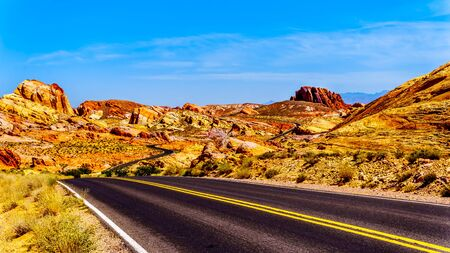 The colorful Aztec sandstone rock formations along the White Domes Road as it winds through the Valley of Fire State Park in Nevada, USA Reklamní fotografie