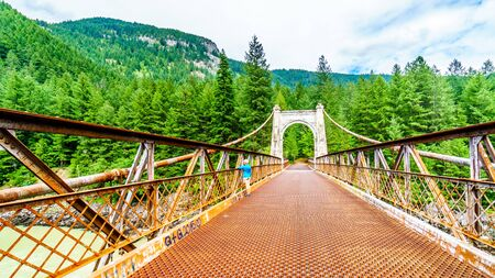 The historic Second Alexandra Bridge between Spuzzum and Hell's Gate along the Trans Canada Highway in British Columbia, Canada Фото со стока