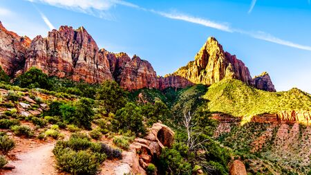 Sunrise over The Watchman peak in Zion National Park in Utah, USA, during an early morning hike on the Watchman Trail. Bridge Mountain on the left