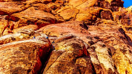 Climbers repelling from the Red Rocks at the Guardian Angel Trail in Red Rock Canyon National Conservation Area near Las Vegas, Nevada, United States
