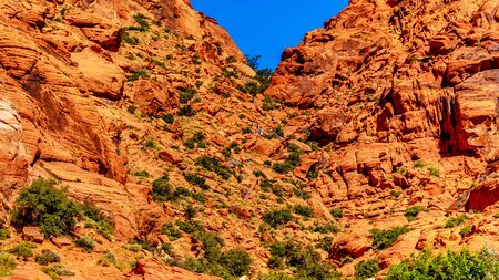 Hikers coming over the ridge from the Calico Trail into the Guardian Angel Area of Red Rock Canyon National Conservation Area near Las Vegas, Nevada, United States