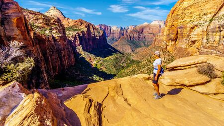 Active Senior Woman looking into Zion Canyon from the top of the Canyon Overlook Trail in Zion National Park, Utah, United States