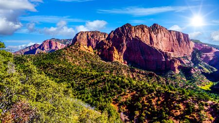 Sunrise over the red rocks of Timber Top Mountain in the Kolob Canyon part of Zion National Park, Utah, United Sates. Viewed from the Timber Creek Lookout at the top of the East Kolob Canyon Road