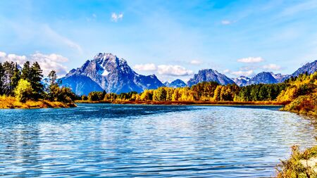 Mount Moran and surrounding Mountains in the Teton Mountain Range of Grand Teton National Park. Viewed from Oxbow Bend of the Snake River in Wyoming, United Sates