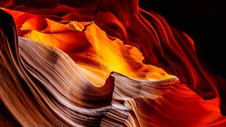 Looking up at the smooth curved Red Navajo Sandstone walls of the Upper Antelope Canyon, one of the famous Slot Canyons in the Navajo lands near Page Arizona, United States Stock Photo