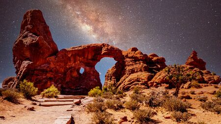 The night sky and milky way over the delicate Sandstone Arch of the Turret Arch, one of the many large Sandstone Arches in Arches National Park Utah, United States under a Starry Sky Stock Photo