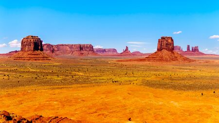 Merrick Butte, Mitten Buttes and Sentinel Mesa, massive Red Sandstone Buttes and Mesas in Monument Valley, a Navajo Tribal Park on the border of Utah and Arizona, United States