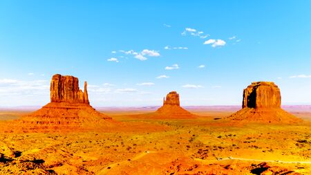 The sandstone formations of East and West Mitten Buttes and Merrick Butte in Monument Valley Navajo Tribal Park in southern Utah, United States
