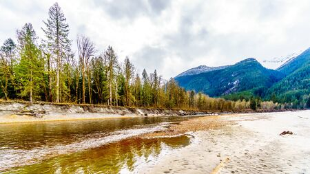 Iron Oxide Stained rocks lining the shore at low water in the Squamish River in the Upper Squamish Valley in British Columbia, Canada