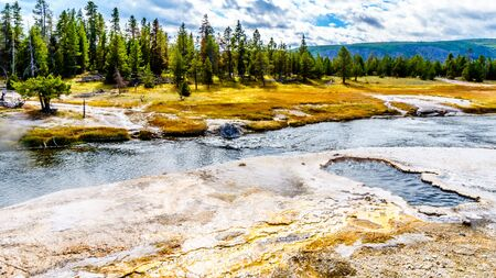 The South Scalloped Spring on the bank of the Firehole River in the Upper Geyser Basin along the Continental Divide Trail in Yellowstone National Park, Wyoming, United States