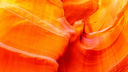 The smooth curved Red Navajo Sandstone walls of Owl Canyon, one of the famous Slot Canyons in the Navajo lands near Page Arizona, United States