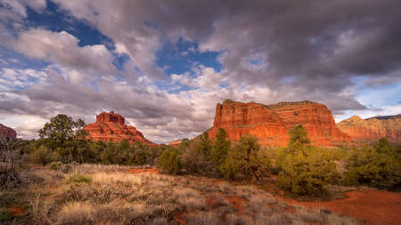 Clouds and blue sky over Bell Rock and Courthouse Butte between the Village of Oak Creek and the town of Sedona in northern Arizona in Coconino National Forest, United States of America
