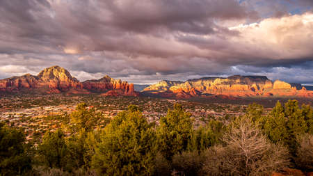 Sunset over Thunder Mountain and other red rock mountains surrounding the town of Sedona in northern Arizona in Coconino National Forest, United States of America